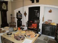 A view of the cooking fire in the Kitchen at Fairfax House, flanked by the range on the right and bread oven on the left (copyright Fairfax House 2011)