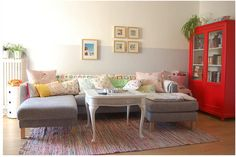 love the granny square afghan on the back of the sofa, the colorful pillows, the striped rug, and the red cabinet!!! via apartment therapy
