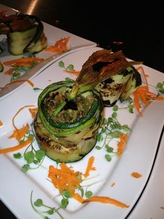 seared zucchini, rolled with prosciutto, stuffed with sauteed zucchini and sauteed blanched and toasted almonds, topped with a sauteed zucchini blossom.