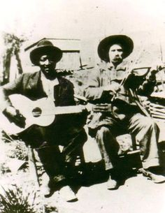 The only known photograph of Arnold Schultz credited with inventing thumb-style guitar made popular by Merle Travis and Chet Atkins. The fiddler is Arnold Pendleton (Uncle Pen) Vandiver. These two shaped Bill Monroe's music more than any other early influence.