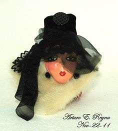 Arturo E.ARTURO E. A dramatic look on this very special brooch. The brooch is hand painted on ceramic. Lady's wearing black velvet high top hat with Veil decorated with Victorian glass button natural white mink collar. Lady Face, Woman Face, Painted Porcelain, Hand Painted, Broach Bouquet, Clay Jewelry, Jewellery, Dramatic Look, Head Pins