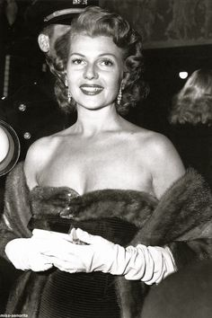 """"""" Looking stunning in a mink-trimmed evening gown, Rita attends the New York premiere of Salome in March 1953. Her appearance caused such a stir that mobs of people had to be held back so that she could enter the..."""