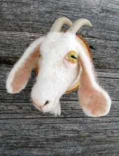 I sort of actually want this fake-mounted needle felted goat head.