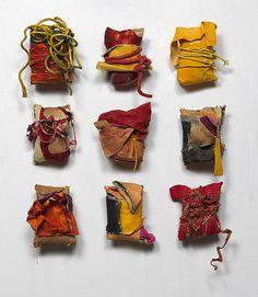 "Diane Cooper, Bundles Red/Yellow Bundles Red/Yellow 32""x32""x6"" canvas, silk , felt, cord www.dianecooper.org"