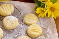 Super simple and quick to make 4 ingredient Paleo Coconut Shortbread Cookies made with coconut flour. Follow the recipe and enjoy these in no time.