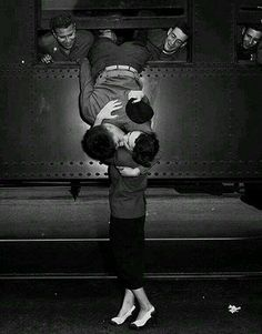 A goodbye kiss in 1950 between a soldier and his love.