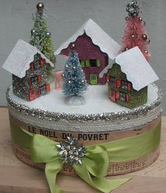 Tiny houses glittered with some of last years bottle brush trees on a prettied up box for Christmas