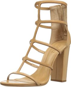 Schutz Women's Sansa Lightwood Sandal. You'll be sure to catch stares from your admirers as you dance the night away in the stunning Schutz® Sansa sandal. Leather upper. Back zippered closure. Open toe. Caged silhouette. Leather lining. Lightly padded footbed. Wrapped block heel. Leather sole. Made in Brazil. Measurements: Heel Height: 4 in Weight: 9 oz Circumference: 9 in Shaft: 5 in Platform Height: 1⁄4 in Product measurements were taken using size 8, width M. Please note that…
