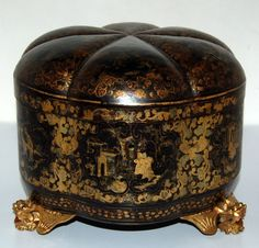 "Chinese export lacquer decorated tea caddy ca.1800-1840. Melon form tea caddy containing two pewter tea canisters all on winged dragon feet, 8½""x8½""x6⅝""."