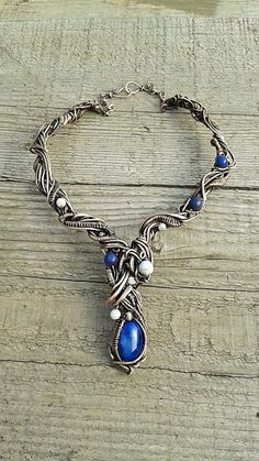 Copper wire wrapped necklaceBlue Queen Fairy by Tangledworld