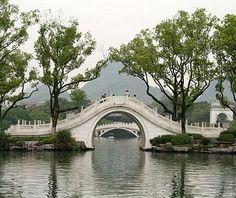 A stone arch bridge at Banyan Lake in Guilin, #China // Spectacular Bridges Around the World