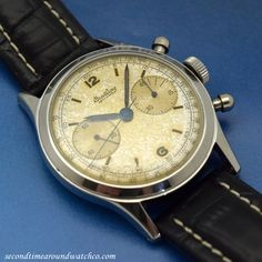 An early 1950's Vintage Breitling 2 Register Chronograph Reference 777. This timepiece features a fantastic, golden patina upon a silver dial with two-subregisters, luminous Arabic numerals and small, bar markers. #breitling #steel #chronograph #chrono #cool #watch #vintage #watches #classic #wristwatch #stawc