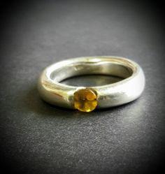 Silver ring with milkenium set yellow sapphire