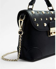 4e1d785ea9 Express studded top handle crossbody bag  affiliatelink This crossbody pops  with personality thanks to eye