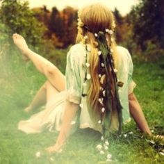 she's just a daydreamer in a field with flowers in her hair