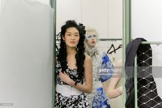 Model Chiharu Okunugi poses Backstage prior the Jean Paul Gaultier Fashion Week on January 25, 2017 in Paris, France.
