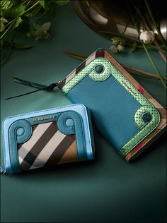 Textured leather, house check and metallic tones combine in our collection of ziparound wallets.