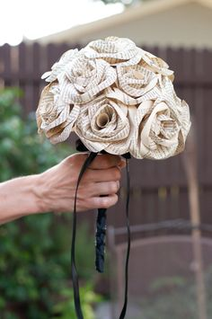 Recycled Book Page Rose Wedding Bouquet. I could use a copy of his favorite book for the bouquet.