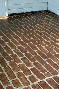 Make a faux brick floor using a sponge and stain! Here are step-by-step instructions.