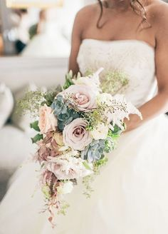This cascading bouquet with succulents is a gorgeous neutral addition to your wedding look.