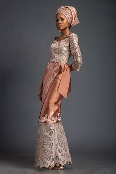 "Mena – Apricot and platinum ""Double wrapper"" style ensemble. Patterned with Komole Kandids Nectar motif. Double Wrapper is finished with signature Deola ""cadeaux bow-back"". African Lace Styles, African Print Dresses, African Dresses For Women, African Attire, African Wear, African Fashion Dresses, African Women, African Prints, African Style"