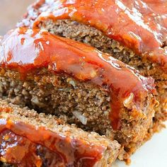 This Meatloaf Recipe is my family's FAVORITE dinner! It's really the Best Ever Meatloaf! Tons of flavor packed inside with a yummy glaze on top. So easy!