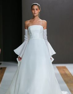 9ac1efb5817 Fall in love with this detached sleeve Mark Zunino gown and these 13 other  gorgeous trends seen at Bridal Fashion Week 2018!