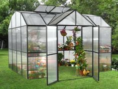 """Royal Garden 10' x 15' Greenhouse by STC. $3749.00. LUX1015 Frame Color: Black Features: -Four roof vents with auto openers.-Full shelving standard.-Double doors for easy access.-Two side vents.-Four auto vent openers, one for each roof vent.-4"""" panels on the roof and crystal clear panels on the sides.-Max inside height is 7"""" x 6"""".-Easy to assemble. Warranty: -Manufacturer provides 10 year warranty on the frame and 7 year warranty on the polycarbonate panels."""