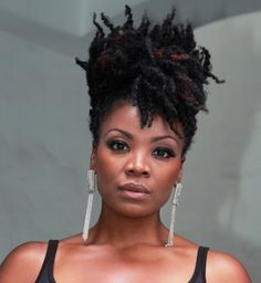 yes. Cute natural hairstyle, kinky curly updo on beautiful black woman. Chic and sexy earrings with black dress too! http://www.shorthaircutsforblackwomen.com/top-50-best-selling-natural-hair-products-updated-regularly/
