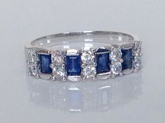 A personal favorite from my Etsy shop https://www.etsy.com/listing/480721973/sapphire-diamond-band18k-diamond