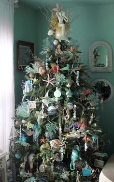 Under the Sea Christmas Tree & oh my.look at that mermaid angel tree topper! Beach Christmas Trees, Coastal Christmas Decor, Nautical Christmas, Christmas Tree Themes, Noel Christmas, Holiday Tree, Xmas Tree, Christmas Tree Decorations, Diy Christmas Angel Tree Topper