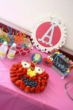 i love this elmo made of strawberries, blueberries, pineapples and cream cups! i nice touch to add something healthy to the party, and it's part of the decor Elmo Party, Rainbow Birthday Party, Elmo Birthday, Boy Birthday Parties, Birthday Ideas, Fruit Birthday, Kid Parties, Party Party, Sesame Street Party