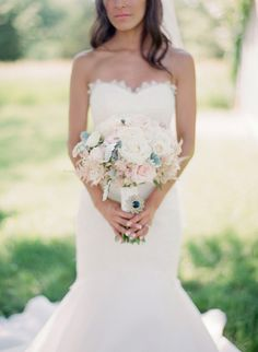 Neutral Blush and Ivory Bridal Bouquet ... love the bouquet, with the navy blue jewel at the hand