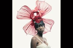 Peter Hapak 2010 / In this picture Taja Hill is wearing a pink flower butterfly headpiece, styled by Niecy Hayes in 2010.