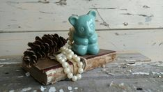 Check out this item in my Etsy shop https://www.etsy.com/listing/123520411/antique-aqua-teddy-bear-planter-vintage