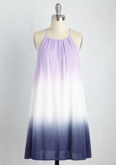 What better way to express your free-spirited attitude than to flaunt this tie-dyed shift dress? With a high, pleated neckline and an ombre lilac, white, and navy dip, this flowy trapeze dress's independent style is the ideal representation of your unrestrained personality!