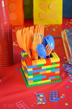 LEGO Birthday Party - The Happy Scraps Lego birthday party utensil holder<br> This Lego Birthday Party was simple to put together and lots of fun. Come to The Happy Scraps to see how to put this party together for yourself. Spongebob Birthday Party, Birthday Party Places, 6th Birthday Parties, Diy Birthday, Lego Birthday Cakes, Diy Lego Birthday Party Ideas, Lego Cake, 5th Birthday Ideas For Boys, Cake Minion