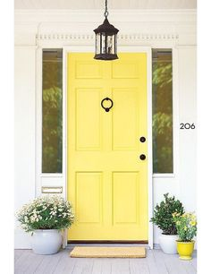 A yellow front door signifies positivity and creativity
