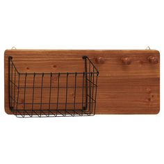 Toss keys and mail into the wire basket of this classic wall rack, then hang scarves and umbrellas on the 3 convenient pegs.  Produc...