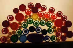 Never imagined bottle caps can be displayed in such a beautiful way. Providing coloured objects with a light table is important for enhancing children's exploration with the light table.