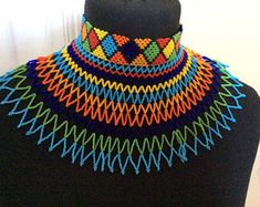 Turtleneck Zulu necklace in organic glass beads. These come in royal blue and yellow . Bleu Royal, Royal Blue, Organic Glass, Shoulder Necklace, Gold Choker, Glass Beads, Beaded Necklace, Chokers, Handmade Items
