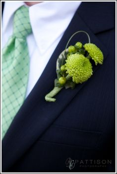 Green boutineer for Joe, groomsmen more white