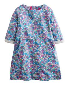 Joules Girls Sweatshirt Dress, Purple Ditsy.                     This dress is so soft and comfortable we think you'll be seeing a lot of it in the coming months.  Sweatshirt detailing and jersey cotton make it a real winner.
