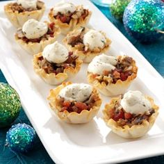 Savory Mushroom Tarts Recipe -When I had drop-in guests, I threw some mini tart appetizers together using mushrooms I had just bought on sale. Everyone gave them rave reviews and thought I'd spent hours cooking.