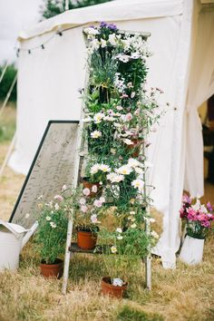 Wild Flower Step Ladder Decor | Lace Belle & Bunty wedding dress | Rustic farm wedding | tipi reception | Sweet pea bouquet | Photography by Shades Of Love | http://www.rockmywedding.co.uk/sarah-mike/