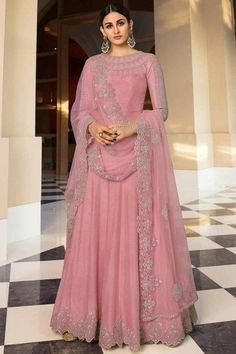Look elegant when wearing this carnation pink dupion silk anarkali suit which will surely make a statement. This round neck and full sleeve party wear dress beautified with stone and zari work. Teamed up with santoon/ lycra churidar in carnation pink color with carnation pink net dupatta. Churidar is plain. Dupatta designed with stone and zari work. #anarkalisuit #usa #Indianwear #Indiandresses #andaazfashion Anarkali, Salwar Kameez, Sari, Embroidery, Suits, Stone, Pink, Women, Fashion