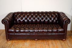 Midcentury Cordovan Chesterfield Sofa w/ Brass Nail Detailing | From a unique collection of antique and modern sofas at http://www.1stdibs.com/furniture/seating/sofas/