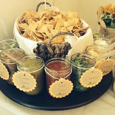 Chips in basket then various salsas and toppings in pint jars. Use dragon themed labels for party.