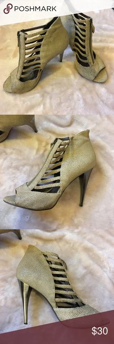 ⭐️Make an Offer⭐️Elizabeth and James Cage Heels Elizabeth and James embossed leather tan heels with a chrome heel. Zipper and cage detailing. Stains on shoes are pictured. Elizabeth and James Shoes Ankle Boots & Booties