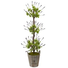 Decorate any room with this eye catching floor plant. Add some greenery to your country decor with this three tiered floor plant. Three tiers of small, green leaves and delicate sprigs of lavender sit on a sturdy brown branch. Comes in a wooden barrel planter with handles.